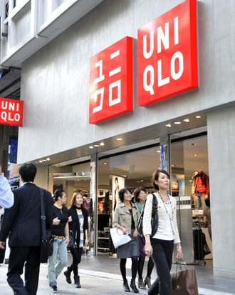Shoppers walk past a branch of Japanese clothes retailer Uniqlo in Tokyo on October 8, 2010. The operator of Japan's cheap-chic clothing chain Uniqlo said it booked a higher annual net profit in the year to August but forecast it to slide 17 percent next year as competition stiffens