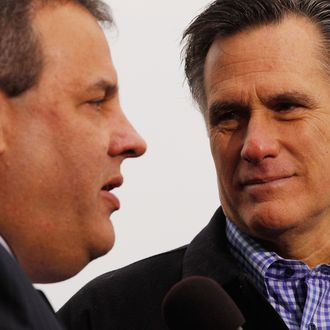 Former Massachusetts Governor and Republican presidential candidate Mitt Romney (R) and New Jersey Governor Chris Christie appear together at a campaign rally at a Hy Vee supermarket December 30, 2011 in West Des Moines, Iowa. Christie, a popular Republican governor who was urged to run for president earlier this year, appeared with Romney just days before the