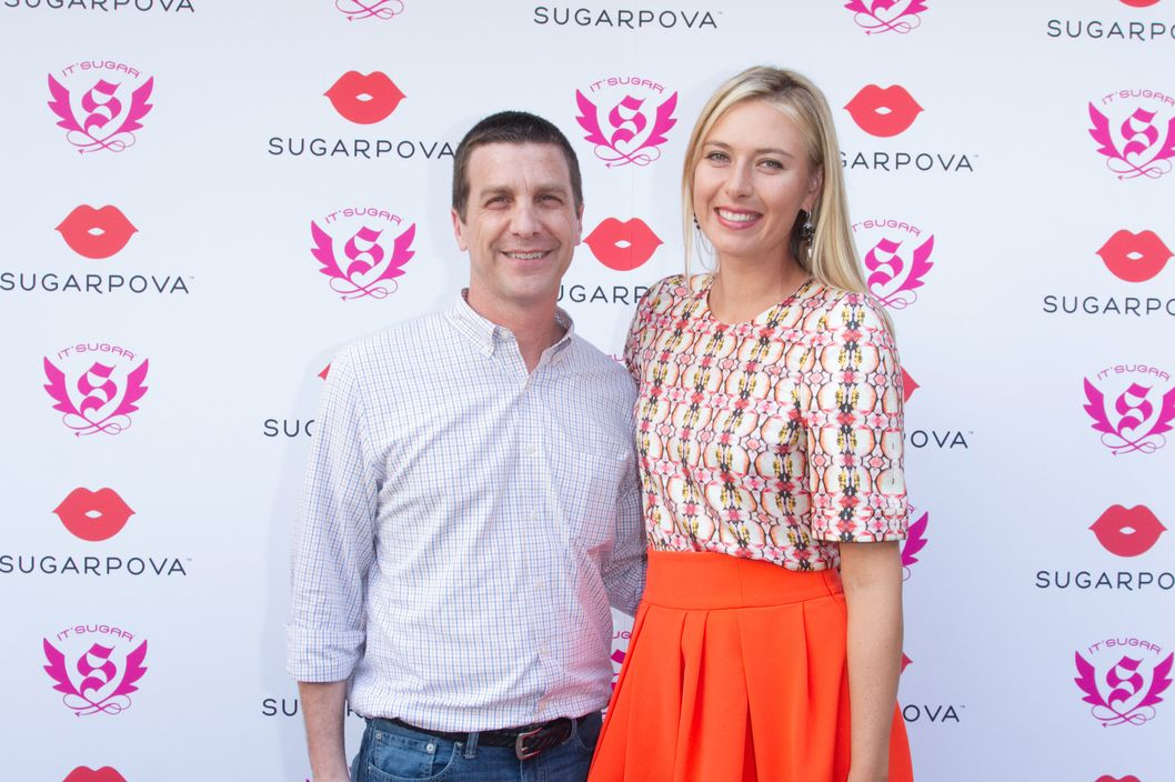 MIAMI, FL - MARCH 19: Maria Sharapova (R) and Jeff Rubin pose during the launch of her candy collection Sugarpova in Miami at IT'SUGAR at Sunset Place on March 19, 2013 in Miami, Florida.