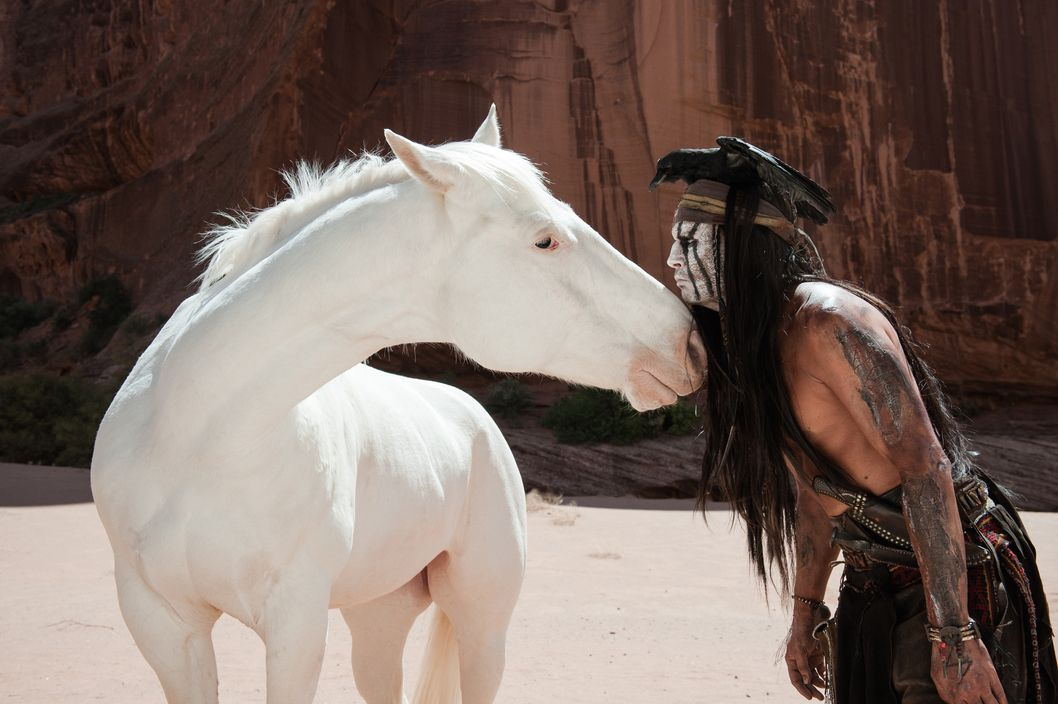 """THE LONE RANGER""L to R: Silver and Johnny Depp as TontoPh: Peter Mountain?Disney Enterprises, Inc. and Jerry Bruckheimer Inc.  All Rights Reserved."
