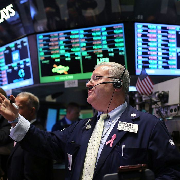 Traders work on the floor of the New York Stock Exchange during afternoon trading on October 4, 2012 in New York City. Following news that European Central Bank president Mario Draghi is committed to the central bank's new bond-buying plan, stocks rose with the Dow Jones Industrial Average gaining 80.75 points.