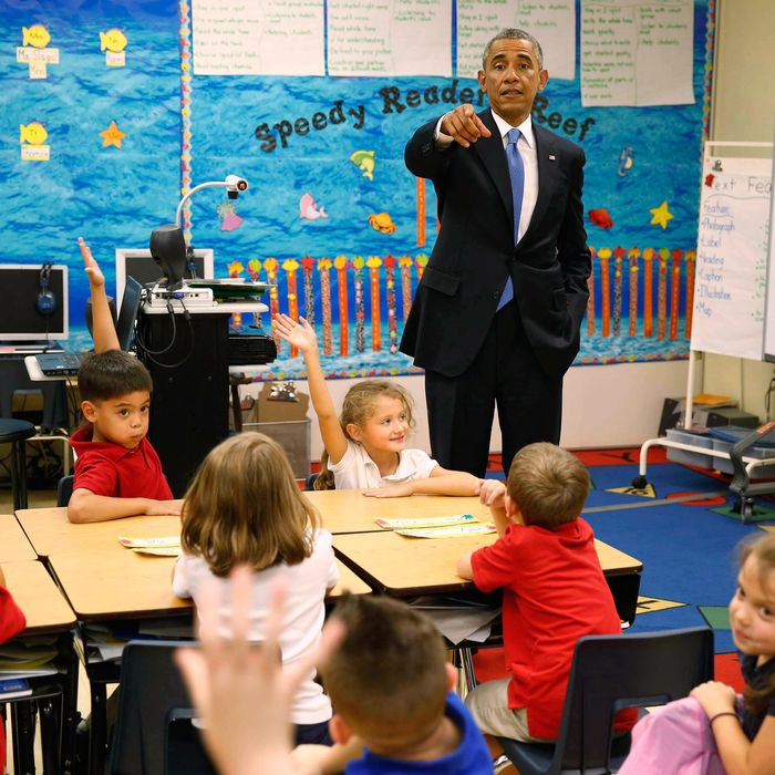 U.S. President Barack Obama visits the classroom of teacher Elizabeth Slagal, during a visit to the Clarence Tinker elementary schoolchildren while at MacDill Air Force Base in Tampa, Florida, September 17, 2014. REUTERS/Larry Downing (UNITED STATES - Tags: POLITICS MILITARY EDUCATION) --- Image by ? LARRY DOWNING/Reuters/Corbis