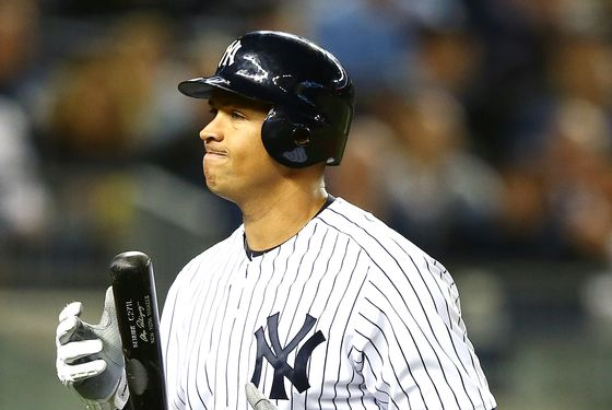 Alex Rodriguez #13 of the New York Yankees reacts after striking out  during Game Three of the American League Division Series against the Baltimore Orioles at Yankee Stadium on October 10, 2012 in the Bronx borough of New York City.