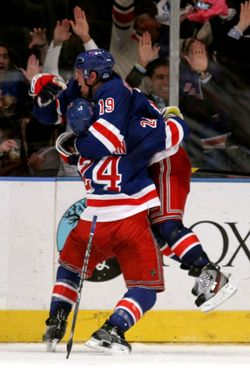 NEW YORK, NY - MAY 07:  Brad Richards #19 of the New York Rangers celebrates with teammate Ryan Callahan #24  after scoring a goal to tie up the game late in the third period against Braden Holtby #70 of the Washington Capitals in Game Five of the Eastern Conference Semifinals during the 2012 NHL Stanley Cup Playoffs at Madison Square Garden on May 7, 2012 in New York City.  (Photo by Bruce Bennett/Getty Images)
