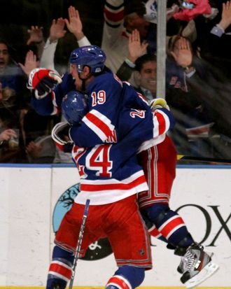 Brad Richards #19 of the New York Rangers celebrates with teammate Ryan Callahan #24 after scoring a goal to tie up the game late in the third period against Braden Holtby #70 of the Washington Capitals in Game Five of the Eastern Conference Semifinals during the 2012 NHL Stanley Cup Playoffs at Madison Square Garden on May 7, 2012 in New York City.