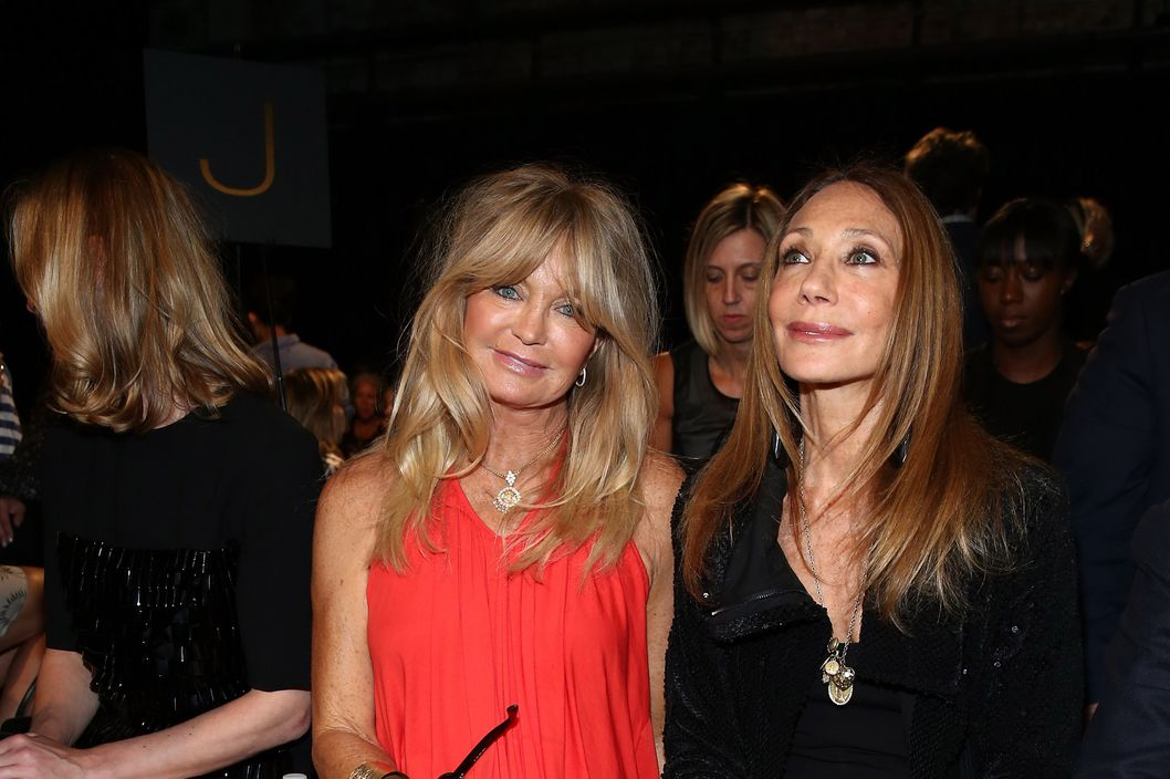 NEW YORK, NY - SEPTEMBER 09:  Goldie Hawn and Marisa Berenson attend the Donna Karan fashion show during Mercedes-Benz Fashion Week Spring 2014 on September 9, 2013 in New York City.  (Photo by Neilson Barnard/Getty Images)