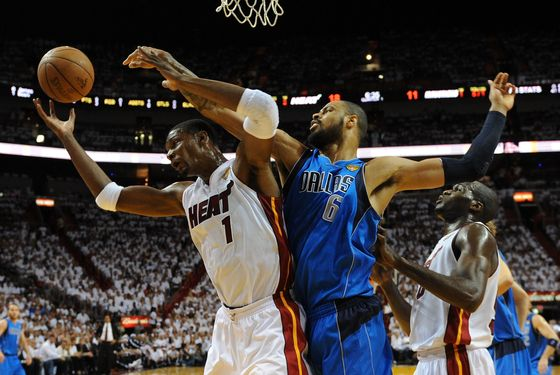 MIAMI, FL - JUNE 12:  Chris Bosh #1 of the Miami Heat and Tyson Chandler #6 of the Dallas Mavericks fight for control of the ball in the first half of Game Six of the 2011 NBA Finals at American Airlines Arena on June 12, 2011 in Miami, Florida. NOTE TO USER: User expressly acknowledges and agrees that, by downloading and/or using this Photograph, user is consenting to the terms and conditions of the Getty Images License Agreement.  (Photo by Don Emmert-Pool/Getty Images)