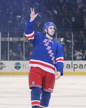 Chris Kreider #20 of the New York Rangers waves to the crowd after being named a star of the game in their 3 to 1 win over the Washington Capitals in Game One of the Eastern Conference Semifinals during the 2012 NHL Stanley Cup Playoffs at Madison Square Garden on April 28, 2012 in New York City.