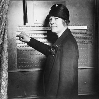 09 Oct 1928 --- Original caption: 10/9/1928- New York, NY- Women Candidate for Congress Shows How to Use the Voting Machine. An added attraction of the campaign waged by the Republicans in the present election is the school in New York City, where voters are instructed in the art of using the voting machine. Photo shows Mrs. Ruth Pratt, Republican Candidate for Congress from New York, showing how the machine works. --- Image by © Bettmann/CORBIS