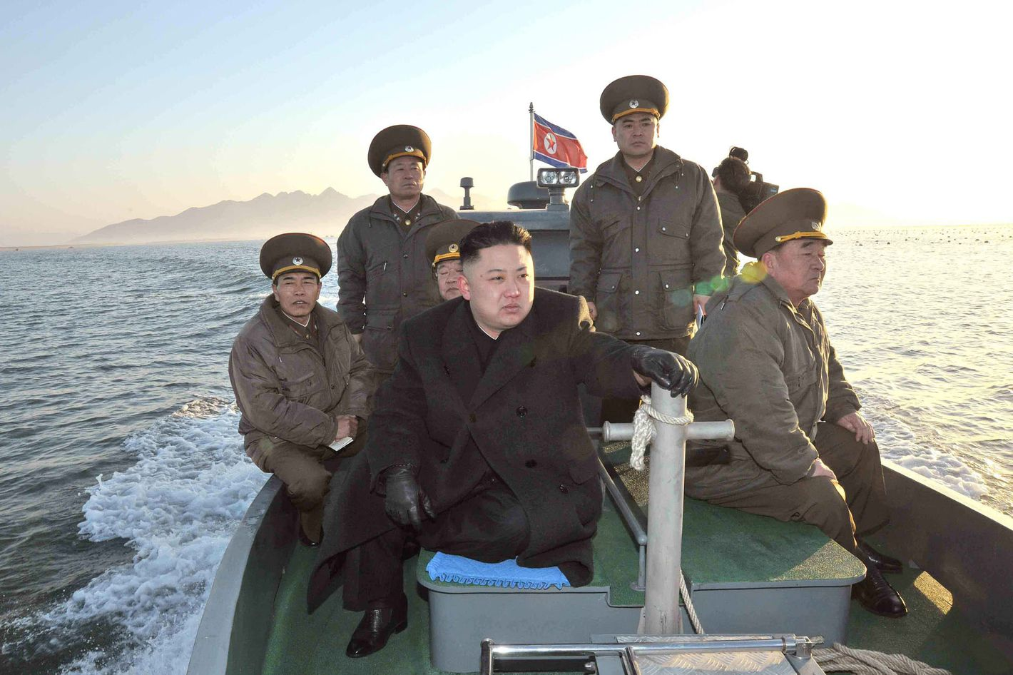 """In this March 11, 2013 photo released by the Korean Central News Agency (KCNA) and distributed March 12, 2013 by the Korea News Service, North Korean leader Kim Jong Un rides on a boat, heading for the Wolnae Islet Defense Detachment, North Korea, near the western sea border with South Korea. North Korea's young leader urged front-line troops to be on """"maximum alert"""" for a potential war as a state-run newspaper said Pyongyang had carried out a threat to cancel the 1953 armistice that ended the Korean War."""
