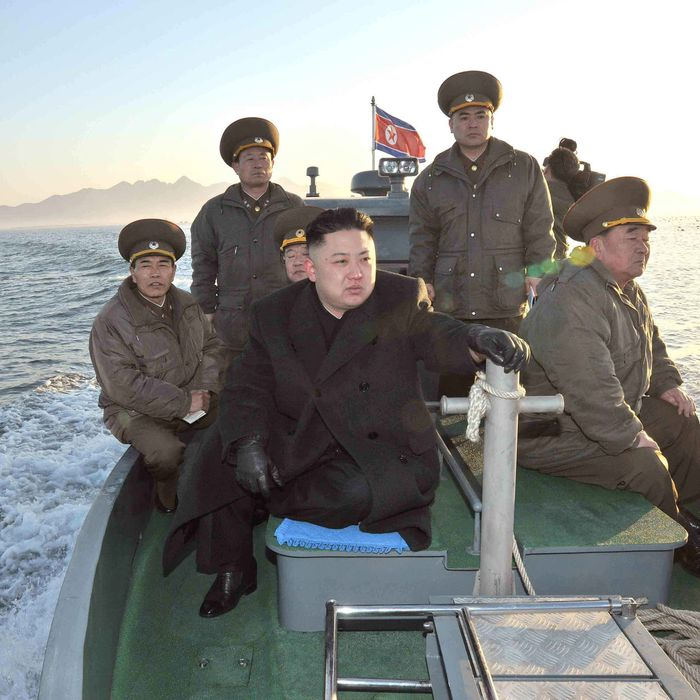 In this March 11, 2013 photo released by the Korean Central News Agency (KCNA) and distributed March 12, 2013 by the Korea News Service, North Korean leader Kim Jong Un rides on a boat, heading for the Wolnae Islet Defense Detachment, North Korea, near the western sea border with South Korea. North Korea's young leader urged front-line troops to be on