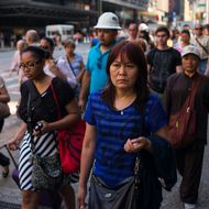 NEW YORK, NY - JULY 7: Morning commuters walk to their offices July 7, 2014 across from the Port Authority Bus Terminal in the Manhattan borough of New York City. (Photo by Robert Nickelsberg/Getty Images)
