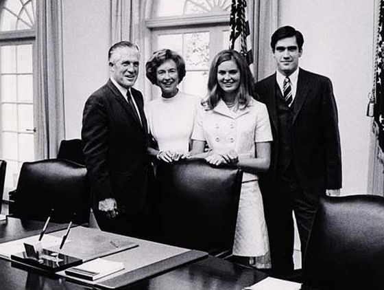 Young Mitt Romney: styled exactly the same as Older Mitt Romney.