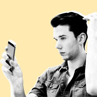 17 Jan 2014 --- Young man taking selfie on smartphone in living room --- Image by ? Frank Van Delft/Cultura/Corbis