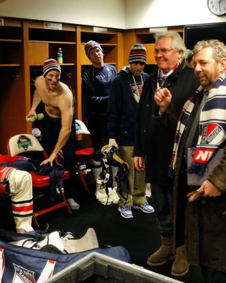 General manager Glen Sather and James Dolan, President and CEO of Cablevision Systems Corporation and Executive Chairman of Madison Square Garden, speak to the New York Rangers after they defeated the Philadelphia Flyers in the 2012 Bridgestone NHL Winter Classic at Citizens Bank Park on January 2, 2012 in Philadelphia, Pennsylvania.