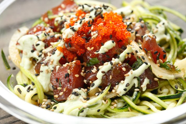 The West Swell over zucchini noodles: ahi tuna, sweet onions, tobiko, wasabi-avocado cream, herbs, and Wisefish sauce.