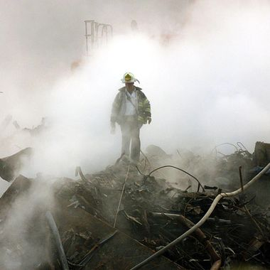 A fireman walks amongst the rubble and the smoldering wreckage of the World Trade Center 11 October 2001 in New York.  An interfaith ceremony was held at ground zero in conjunction with the one month anniversary of the attacks, marked by the short prayer service and a moment of silence at 8:48am.   AFP Photo/POOL/Gary Friedman (Photo credit should read GARY FRIEDMAN/AFP/Getty Images)