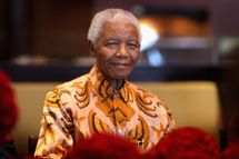 CAPE TOWN, SOUTH AFRICA - APRIL 03:  Nelson Mandela smiles during a lunch to Benefit the Mandela Children's Foundation as part of the celebrations of the opening of the new One&Only Cape Town resort on April 3, 2009 in Cape Town, South Africa. The One&Only is Sol Kerzner's first hotel in his home country since 1992. The 130 room property is One&Only's first Urban resort and sits in the fashionable Waterfront district. Celebrities from all over the world including Mariah Carey, Clint Eastwood, Matt Damon, Morgan Freeman, Thandie Newton and Marisa Tomei will attend the event. Gordon Ramsay will be launching his first restaurant in Africa at the resort, Maze and Robert De Niro will be opening Nobu. Nelson Mandela will be attending an intimate luncheon at Maze on Friday to celebrate his long-standing relationship with Mr. Kerzner.  (Photo by Chris Jackson/Getty Images)