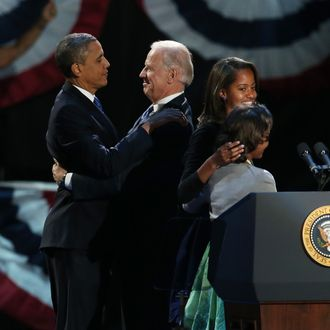 CHICAGO, IL - NOVEMBER 06: U.S. President Barack Obama and U.S. Vice President Joe Biden embrace on stage with family after his victory speech on election night at McCormick Place November 6, 2012 in Chicago, Illinois. Obama won reelection against Republican candidate, former Massachusetts Governor Mitt Romney. (Photo by Win McNamee/Getty Images)