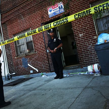 Police stand near the scene of a murder in New York