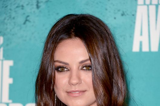 Actress Mila Kunis poses in the press room during the 2012 MTV Movie Awards held at Gibson Amphitheatre on June 3, 2012 in Universal City, California.