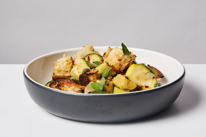Olive oil-poached zucchini with capers, oregano, and grilled bread.