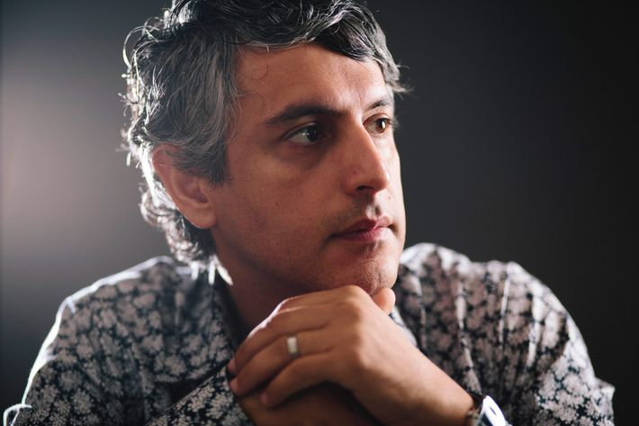 """Dr. Reza Aslan, author of the book """"Zelot"""" poses at his home on August 8, 2013, in Los Angeles, California. Dr. Aslan's doctorate in the sociology of religions encompasses expertise in the history of religion. Aslan's bachelor's degree is in religious studies, with an emphasis on scripture and traditions. His minor was in biblical Greek. He has a master of theological studies degree from Harvard University, in world religions, and a Ph.D. from the University of California, Santa Barbara, in the sociology of religions. Reza also has a master of fine arts degree from the University of Iowa. Dr. Aslan is currently associate professor of creative writing at the University of California, Riverside, and a cooperative faculty member in the department of religion, and he teaches in both disciplines. He was previously Wallerstein Distinguished Visiting Professor of religion at Drew University, where he taught from 2012 to 2013, and assistant visiting professor of religion at the University of Iowa, where he taught from 2000 to 2003. He has written three books on religion."""