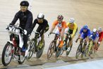 (Second from left) Track cyclists Mohd Azizulhasni Awang of Malaysia, Teun Mulder of the Netherlands, Shane Kelly of Australia, Teun Mulder of the Netherlands, Andrii Vynokurov of Ukraine, Sergey Polynskiy of Russia and Feng Yong of China, compete in the 2008 Beijing Olympic Games men's keirin first round at the Laoshan Velodrome in Beijing on August 16, 2008.