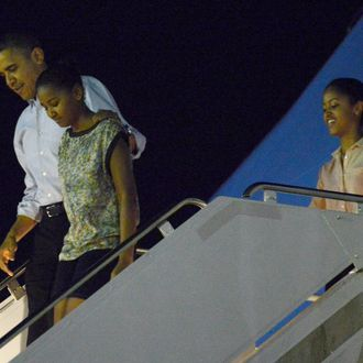 HONOLULU, HI - DECEMBER 22: US President Barack Obama disembarks Obama Air Force One with daughters Natasha and Malia at Joint Base Pearl Harbor-Hickam on December 22, 2012 in Honolulu, Hawaii. Hawaii. The president and his family spend the Christmas holiday in Hawaii, Obama's birthplace. (Photo by Cory Lum-Pool/Getty Images)