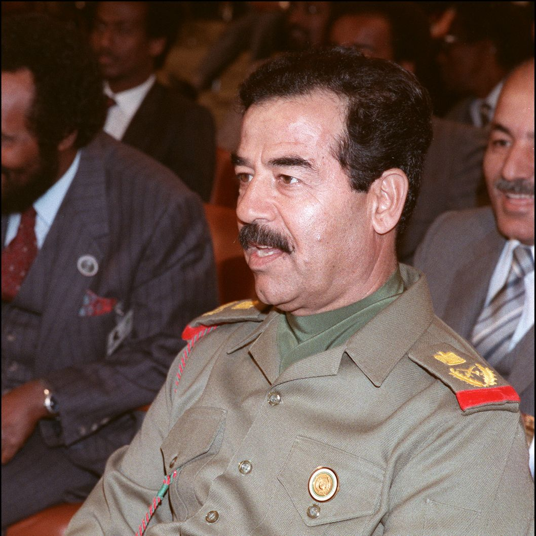 "Iraqi President Saddam Hussein 10 November 1987 in Amman during a session of the emergency Arab summit. Saddam took the number two job under president Ahamd Hassan al-Bakr, began purging the army of non-Baathist officers, ridding the political scene of Kurds and communists. When Bakr stepped down, officially for health reasons, the stage was set for Saddam, who became president on 16 July 1979. Fearing the impact of Tehran's Islamic revolution on Iraq's majority Shiite Moslem population, Saddam launched a war against Iran in 1980 to defend ""the eastern flank of the Arab nation from the Persian. But he only managed to obtain a cease-fire in 1988. On 02 August 1990, Saddam directed his army against Kuwait. In February 1991 a multinational coalition led by the United States chased Iraqi troops out of he emirate.  (Photo credit should read MONA SHARAF/AFP/Getty Images)"
