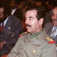 Iraqi President Saddam Hussein 10 November 1987 in Amman during a session of the emergency Arab summit. Saddam took the number two job under president Ahamd Hassan al-Bakr, began purging the army of non-Baathist officers, ridding the political scene of Kurds and communists. When Bakr stepped down, officially for health reasons, the stage was set for Saddam, who became president on 16 July 1979. Fearing the impact of Tehran's Islamic revolution on Iraq's majority Shiite Moslem population, Saddam launched a war against Iran in 1980 to defend