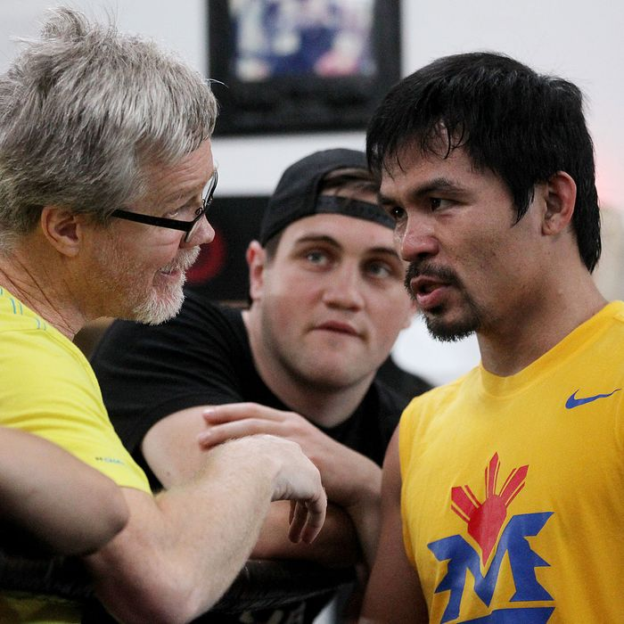 LOS ANGELES, CA - MARCH 9: Manny Pacquiao, right, talks with trainer Freddie Roach as the Filipino prizefighter opens training camp at the Wild Card Boxing Gym on March 9, 2015 in Los Angeles, California. Pacquiao is in preparation for a much anticipated match against Floyd Mayweather in about two months. (Photo by Luis Sinco/Los Angeles Times via Getty Images)