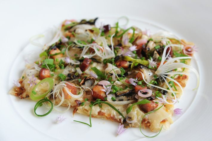 Spring-onion and bacon flatbread.
