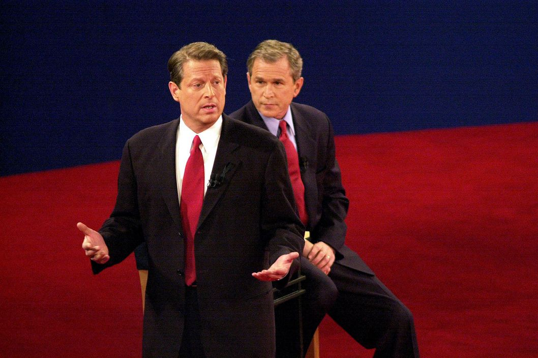 380434 08: Democratic presidential candidate Vice President Al Gore talks to the audience while the Republican candidate Texas governor George W. Bush looks on October 17, 2000 in St. Louis, Missouri at the third and final presidential debate of the campaign. (Photo by Bill Greenblatt/Liaison)