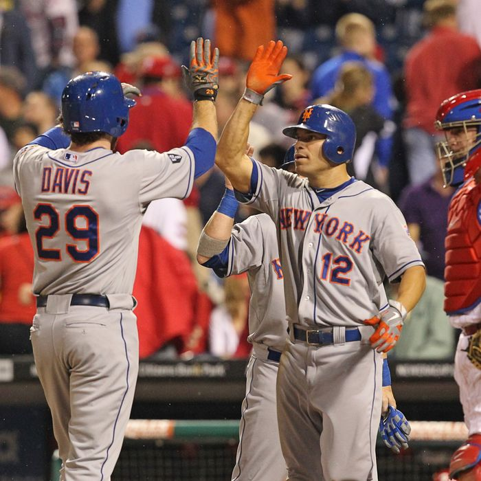 First baseman Ike Davis #29 of the New York Mets is congratulated by right fielder Scott Hairston #12 after hitting a home run during a game against the Philadelphia Phillies at Citizens Bank Park on May 9, 2012 in Philadelphia, Pennsylvania.