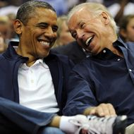 WASHINGTON, DC - JULY 16: U.S. President Barack Obama and Vice President Joe Biden share a laugh as the US Senior Men's National Team and Brazil play during a pre-Olympic exhibition basketball game at the Verizon Center on July 16, 2012 in Washington, DC. (Photo by Patrick Smith/Getty Images)