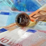A picture taken on December 15, 2011 in the northern city of Lille, shows a coin of one Euro and banknotes of 10, 20 and 50 Euros. AFP PHOTO PHILIPPE HUGUEN (Photo credit should read PHILIPPE HUGUEN/AFP/Getty Images)