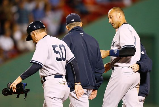 BOSTON, MA - SEPTEMBER 12: Derek Jeter #2 of the New York Yankees walks off of the field with first base coach Mick Kelleher #50 and manager Joe Girardi #28 after injuring himself on a close play at first base against the Boston Red Sox during the game on September 12, 2012 at Fenway Park in Boston, Massachusetts.  (Photo by Jared Wickerham/Getty Images) Mick Kelleher; Joe Girardi