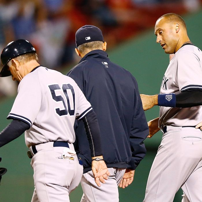 Derek Jeter #2 of the New York Yankees walks off of the field with first base coach Mick Kelleher #50 and manager Joe Girardi #28 after injuring himself on a close play at first base against the Boston Red Sox during the game on September 12, 2012 at Fenway Park in Boston, Massachusetts.