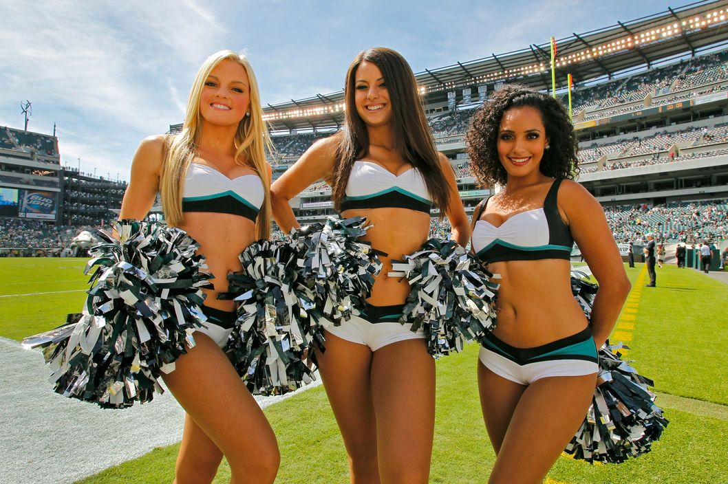 Philadelphia Eagles cheerleaders pose for a photo wearing their new uniforms designed by Vera Wang before a game against the San Diego Chargers on September 15, 2013 at Lincoln Financial Field in Philadelphia, Pennsylvania.