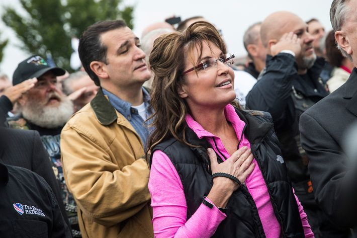 WASHINGTON, DC - OCTOBER 13: Former Alaskan Governor Sarah Palin (R) and Sen. Ted Cruz (R-TX) recite the Pledge of Allegiance at a rally supported by military veterans, Tea Party activists and Republicans, regarding the government shutdown on October 13, 2013 in Washington, DC. The rally was centered around re-opening national memorials, including the World War Two Memorial in Washington DC, though the rally also focused on the government shutdown and frustrations against President Obama. (Photo by Andrew Burton/Getty Images)