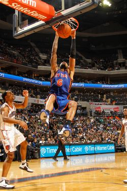 CHARLOTTE, NC - JANUARY 24:  Tyson Chandler #6 of the New York Knicks dunks against Derrick Brown #4 of the Charlotte Bobcats during the game at the Time Warner Cable Arena on January 24, 2012 in Charlotte, North Carolina.  NOTE TO USER: User expressly acknowledges and agrees that, by downloading and or using this photograph, User is consenting to the terms and conditions of the Getty Images License Agreement.  Mandatory Copyright Notice:  Copyright 2012 NBAE (Photo by Kent Smith/NBAE via Getty Images)