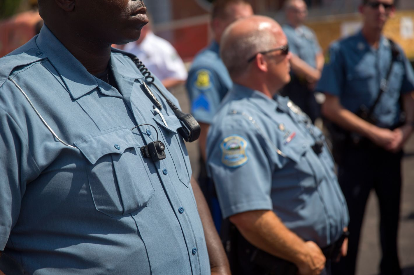 FERGUSON, MO - AUGUST 30: Members of the Ferguson Police department wear body cameras during a rally August 30, 2014 in Ferguson, Missouri.  Michael Brown, an 18-year-old unarmed teenager, was shot and killed by Ferguson Police Officer Darren Wilson on August 9. His death caused several days of violent protests along with rioting and looting in Ferguson. (Photo by Aaron P. Bernstein/Getty Images)