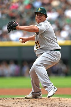 CHICAGO, IL - AUGUST 12:  Starting pitcher Bartolo Colon #21 of the Oakland Athletics delivers the ball against the Chicago White Sox at U.S. Cellular Field on August 12, 2012 in Chicago, Illinois. The White Sox defeated the Athletics 7-3.  (Photo by Jonathan Daniel/Getty Images) *** Local Caption *** Bartolo Colon
