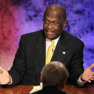 Former CEO of Godfather's Pizza Herman Cain speaks during the Republican Presidential debate hosted by Bloomberg and the Washington Post on October 11, 2011 at Dartmouth College in Hanover, New Hampshire. Eight GOP candidates met for the first debate of the 2012 campaign focusing solely on the economy. (Photo by Justin Sullivan/Getty Images)