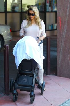 Reality star Kim Kardashian and Kanye West take their baby North to a doctor's visit on October 10, 2013 in Beverly Hills, California.