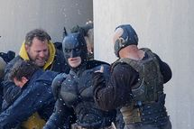 Actor Christian Bale who plays Batman fights actor Tom Hardy who plays villain Bane on the front steps of Gotham City Hall in Pittsburgh, PA. At one point in the fight scene Tom Hardy's pants had a wardrobe malfunction as his whole thigh was showing out of his villain outfit. The scene had hundreds of extras dressed as police men and bad guys fighting. There was also a snow machine on hand blowing onto the scene as they fought. <P> Pictured: Christian Bale and Tom Hardy <P> <B>Ref: SPL302280  310711  </B><BR/> Picture by: Jason Winslow / Splash News<BR/> </P><P> <B>Splash News and Pictures</B><BR/> Los Angeles:	310-821-2666<BR/> New York:	212-619-2666<BR/> London:	870-934-2666<BR/> photodesk@splashnews.com<BR/> </P>