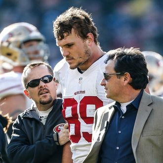 CHICAGO, IL - DECEMBER 6: Vice President of Football Operations Jeff Ferguson of the San Francisco 49ers helps Vance McDonald #89 for a concussion test during the game against the Chicago Bears at Soldier Field on December 6, 2015 in Chicago, Illinois. The 49ers defeated the Bears 26-20. (Photo by Michael Zagaris/San Francisco 49ers/Getty Images)