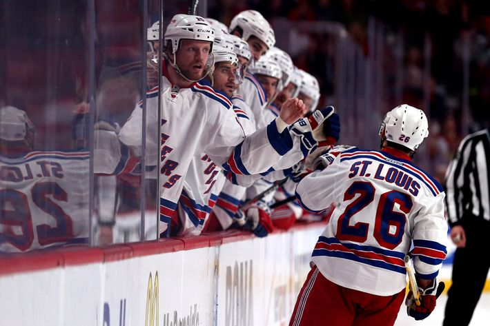 Martin St. Louis #26 of the New York Rangers celebrates with his teammates on the bench after scoring a goal against Dustin Tokarski #35 of the Montreal Canadiens during the second period in Game Two of the Eastern Conference Final during the 2014 Stanley Cup Playoffs at Bell Centre on May 19, 2014 in Montreal, Canada.