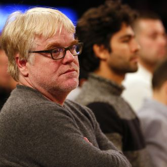 American film actor Philip Seymour Hoffman looks on as the Oklahoma City Thunder play the New York Knicks during an NBA basketball game at Madison Square Garden on December 25, 2013 in New York City.